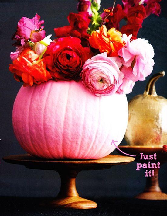 Flower arrangement in a pink pumpkin for Halloween