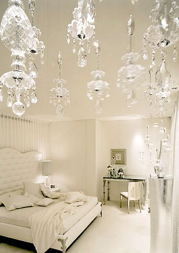 white bedroom with crystal chandelier