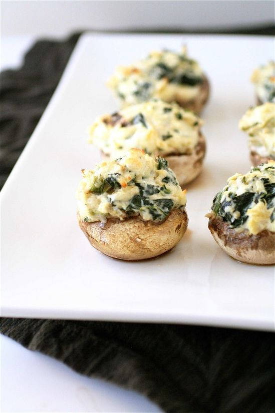 Spinach and Artichoke Stuffed Mushrooms. How delicious for a light supper with a spinach salad or a bowl of soup!