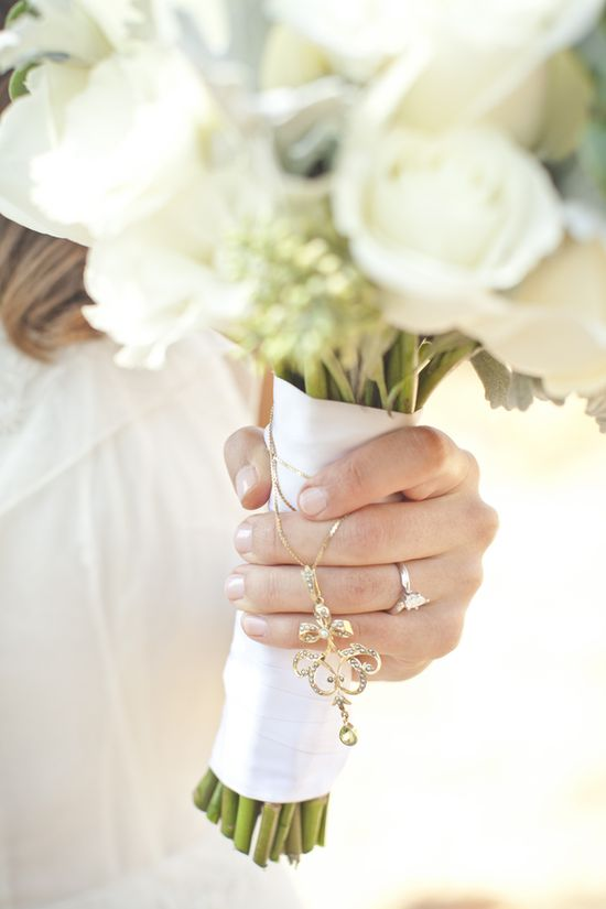 Sweet bouquet charm shot by Vis Photography