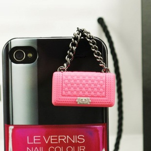 Chanel designer trademark infringing purses for phone plugs.