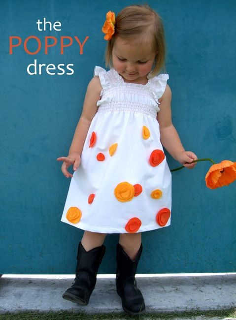 The Poppy Dress ... easy tutorial on a shirred dress with applique.  Love the burst of color on white!