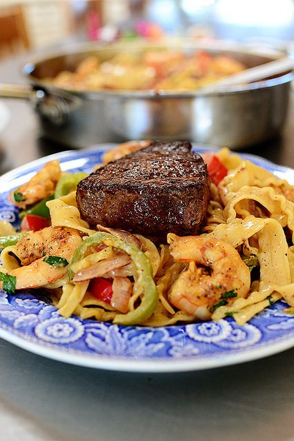 Surf & Turf Cajun Pasta    This is a variation of  Cajun Chicken Pasta, one of the most man-friendly pastas (and gal-friendly, too!) pastas you will find.  It's pretty simple!  All that you need is some frozen shrimp a couple of steaks from the store.  Chop  up some vegetables to add to some cooked pasta.  Combine everything with some Cajun spices and you have a spectacular meal.