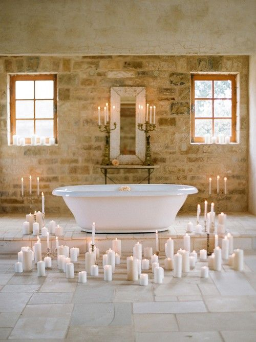 Romantic Bathroom Design With Candles Stone Wall