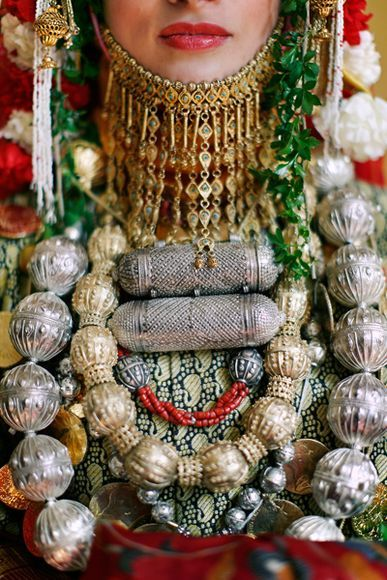 Photograph by Punam Bean  A Jewish Yemenite Henna Ceremony is a tradition dating as far back as the Bronze Age. The bride-to-be is adorned with ornate jewelry and a headdress in the traditional style of wedding attire of Yemenite Jews.  Via National Geographic