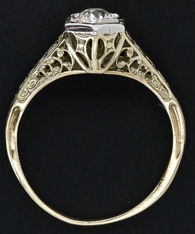 Vintage diamond filigree engagement ring. Via Diamonds in the Library.