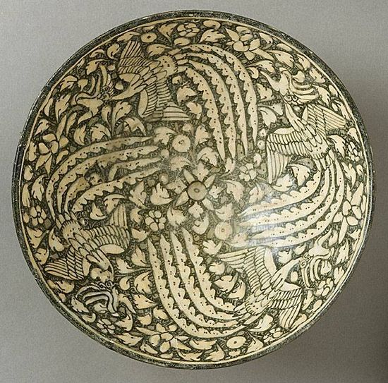 Bowl with Four Phoenixes Iran, Sultanabad Bowl with Four Phoenixes, 14th century Ceramic; Vessel, Fritware, green-gray slip, underglaze-painted, 81/2 x 4 in. (21.5 x 10.2cm) The Nasli M. Heeramaneck Collection, gift of Joan Palevsky (M.73.5.215) Art of the Middle East: Islamic Department.