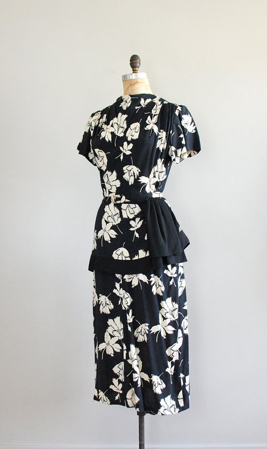 What a gorgeous 1940s floral dress in black and white! If you squint you might think it is Prada.