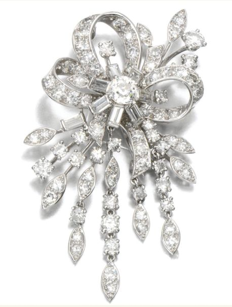 DIAMOND BROOCH, MONTURE CARTIER, 1950S AND PAIR OF EAR CLIPS The brooch of articulated foliate and ribbon design, set with circular-, single-cut and baguette diamonds, signed MTD Cartier