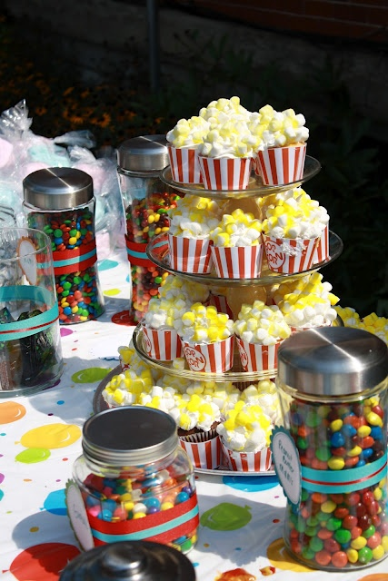 Carnival birthday party :) Cupcakes with marshmallows to look like popcorn