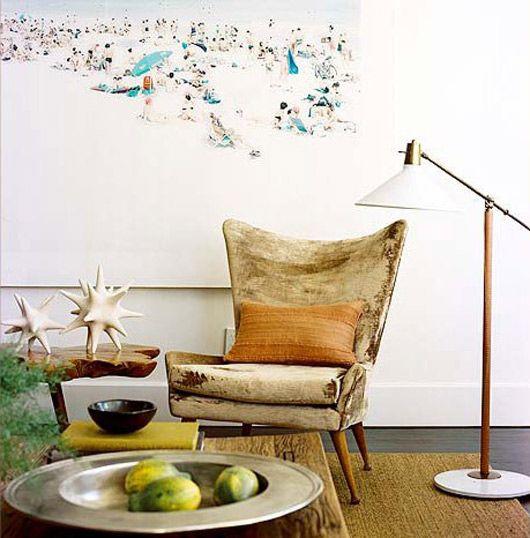 love the gold chair + beach art