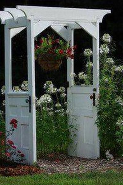 What a lovely arbour - and better yet, it can be made for next to nothing.    A trip to a recyclers (or your local tip shop) is almost sure to turn up some old doors and trims. The two doors in this image aren't even identical!    What do you think? Would you like to make one?