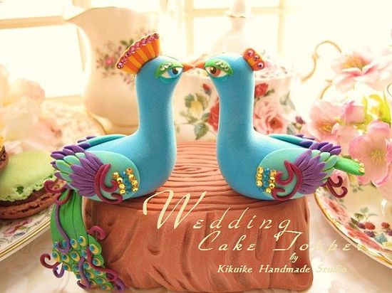 Peacock wedding cake toppers.