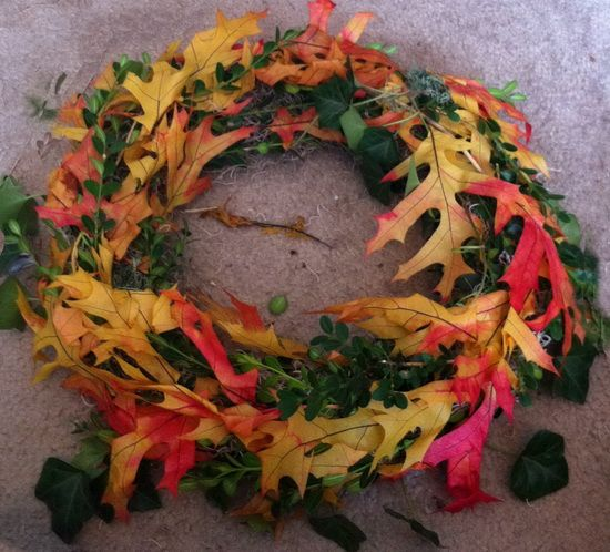 Do It Yourself Fall Wreath - Start to glue all of your real or artificial Fall leaves on the wreath.