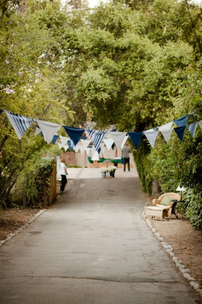 Backyard wedding bunting over driveway. Love this!