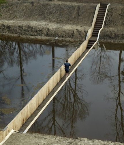 The Moses Bridge, as its name suggests, is a pedestrian bridge that creates the illusion of walking through water. Located near Fort de Roovere in the Netherlands.