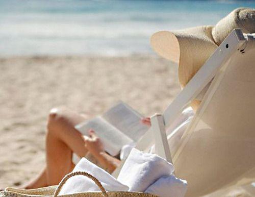 ocean, beach and a book