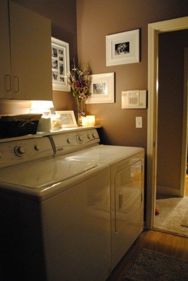 Peaceful looking laundry room  Put a shelf on top of your washer/dryer so things don't fall behind it.