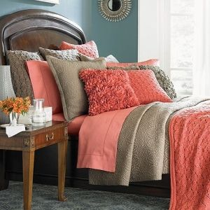 Tan & Coral by nellie colors for living room. Tan walls, brown furniture, coral accents, add teal