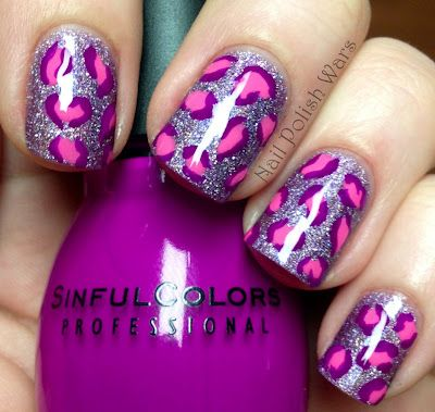 Wildly cool pink and purple leopard print nails that remind me a bit of classic Lisa Frank sticker and stationery designs. #nails #nail #polish #manicure #nail_art #leopard