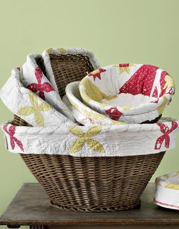 Line baskets with worn vintage quilts
