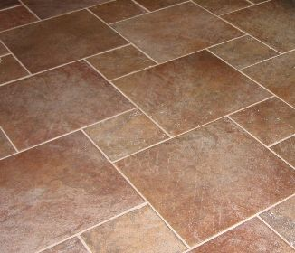 ceramic tile flooring in kitchen and bathrooms