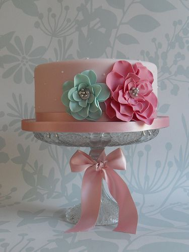 Soft pink cake with turquoise/magenta flowers