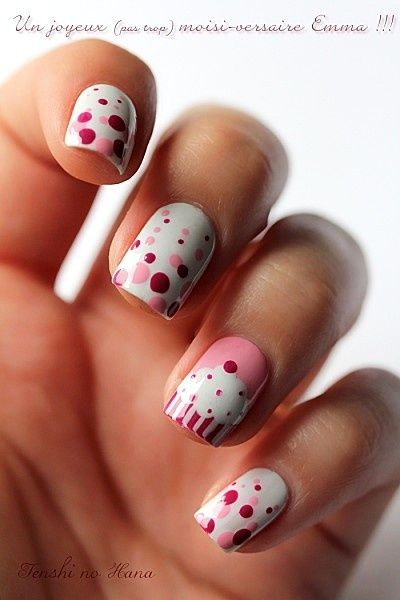 White nail polish with pink and red polka dots, and cupcake accent nail