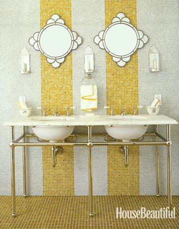 """In a Sonoma country house, designer Jay Jeffers boldly used """"an abundance of glass tiles"""" from Waterworks covering the entire floor and the wall behind a pair of Waterworks sinks. Deco mirrors from Pottery Barn. #stripes #gold"""