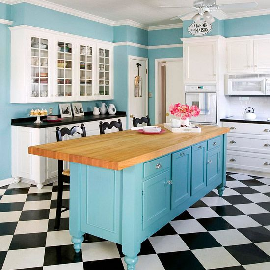 Even if my feng shui guidelines say I should avoid water colors, I'm liking this... Partnering stock cabinetry with stylish embellishments -- such as decorative legs, shining hardware, and a friendly robin's-egg blue finish -- gives this budget-friendly kitchen island a classic, custom look. A wood countertop completes the vintage feel.