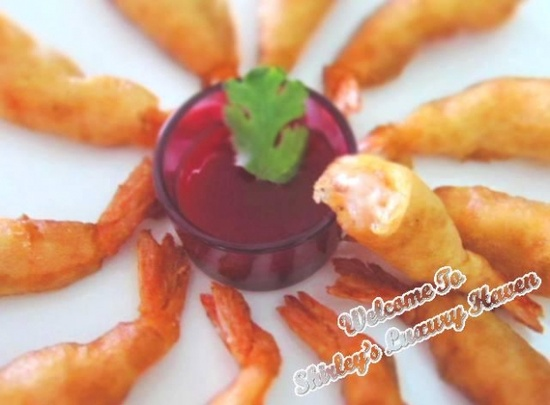 Fluffy Beer Battered Prawns:  Are you a prawn lover like me? If you are, you'll go crazy with this beer battered prawn recipe. Don't drink alcohol? Simply replace it with soda. The use of beer or soda will make your prawns light and crispy. So let's get started!