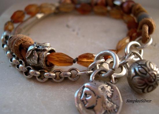 Leather Wrap Bracelet - Garnet Bracelet - Freshwater Pearl Bracelet - Sterling Silver Charm Bracelet - Casual Handmade Bracelet. $148.50, via Etsy.