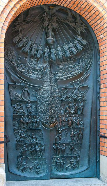 Carved angels and saints door in Poland