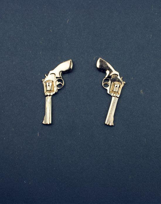 gold revolver earrings