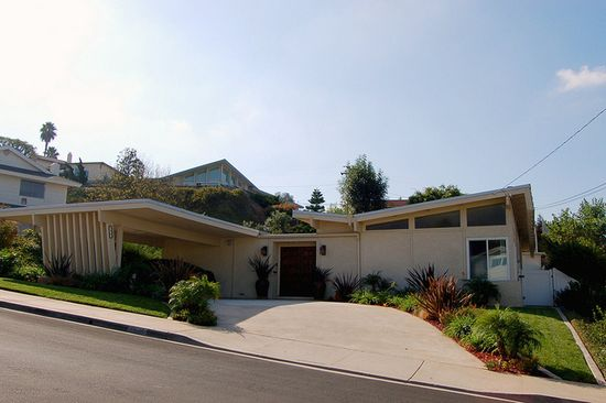 LOVE the buttlefly roof in this mid-century modern home in La Mesa, California