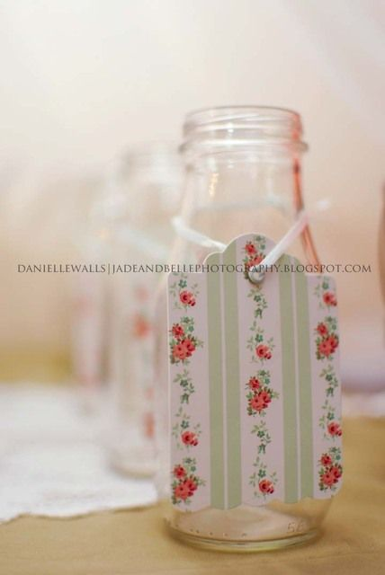 Milk bottles with cute vintage tags at an Ice Cream Party.  See more party ideas at CatchMyParty.com. #icecreampartyideas
