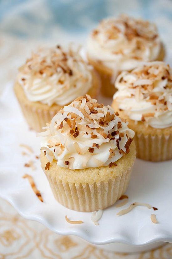 Coconut Cupcakes topped with Coconut Cream Cheese Frosting & a dusting of toasted coconut – It's HEAVEN in a cupcake liner!! #cupcakerecipes