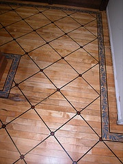 FLOOR STENCILED USING WOOD STAIN.