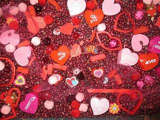 A sensory bin with heart