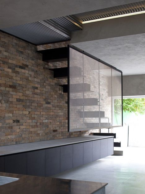 Theres so much going on with this staircase by Paritzki & Liani Architects but it all combines to create a beautifully simple piece of design; the unbonded brickwork, floating treads and framed mesh balustrade combine to create an open, simplistic staircase which sits beautifully in black in an otherwise minimal space.