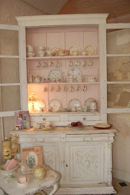 love this pink inside of this cabinet