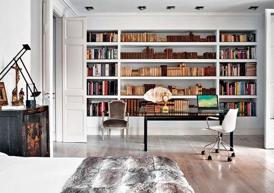 Creative Workspace Inspirations-a home office and library along a bedroom wall.
