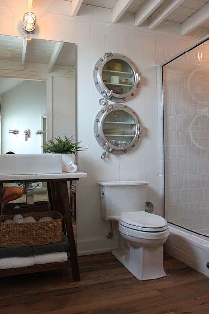 Nautical bathroom with porthole medicine cabinets.