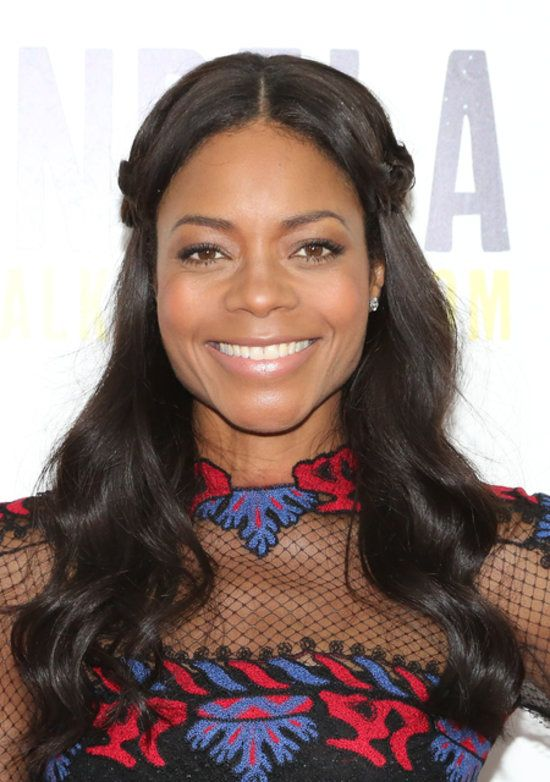 Instead of going for the typical half-up hairstyle, Naomie Harris twisted side sections around a middle part.