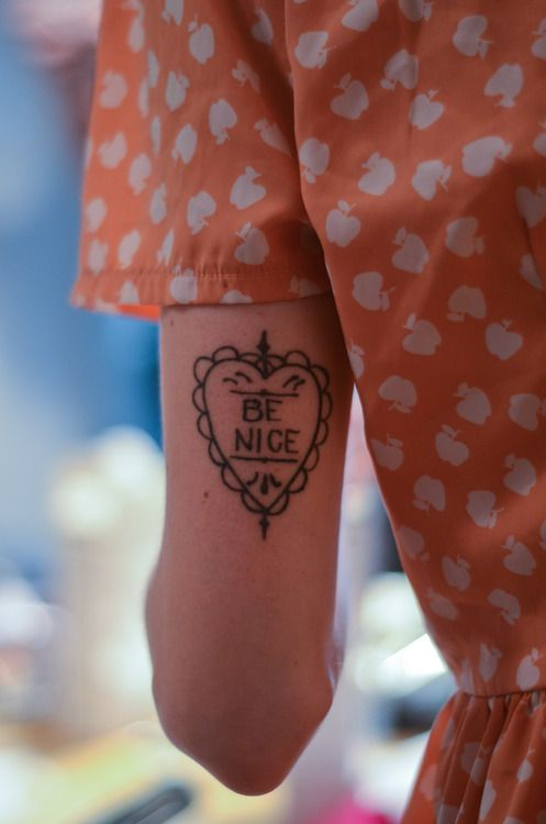 'Be Nice' tattoo.