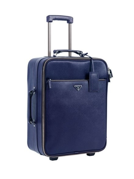 Would love to travel with this Prada Saffiano Trolley! Whether you're traveling for business or pleasure, this navy blue piece of arm candy will get you there with ease and style.
