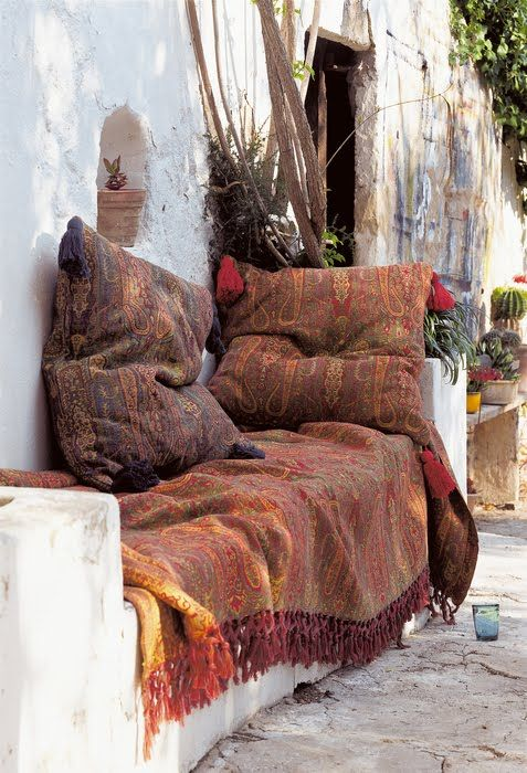 Love the Bohemian Fabrics in this outdoor living space