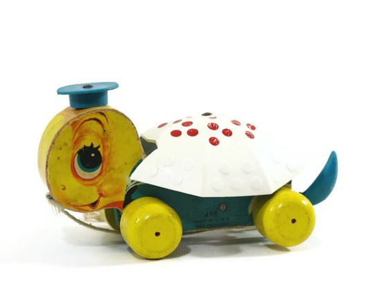 Fisher Price Turtle, Tiny Tim, Wooden Pull Toy, 1960s I still have mine, but an earlier model that has feet that move and the head moves from side to side.