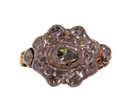 Beautiful early rose cut diamond ring in 18k gold and sterling silver. Circa 1750-1800. Engraved flower detail on back of setting. Most likely English or Dutch in origin.
