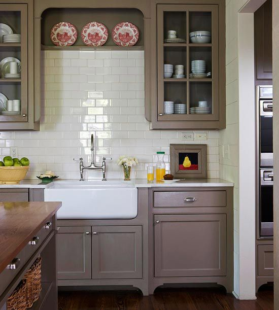 Isn't this neutral kitchen great? We love the subway-tile backsplash and glass-front cabinet doors.